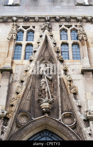 Exeter cathedral, St George and the dragon and saints sculpture carvings. Devon. England - Stock Photo