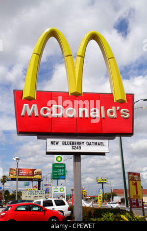 Florida Fort Ft. Pierce signs advertise McDonalds fast food restaurant golden arches business - Stock Photo