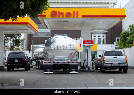 A fuel tank tractor trailer parked at a Shell gas station - California USA - Stock Photo