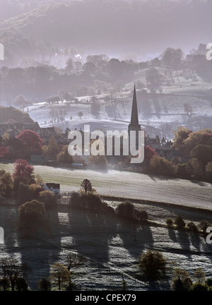 Painswick in early morning mist - Stock Photo