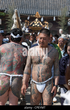 Members of the Japanese yakuza at Sanja Matsuri, Tokyo, Japan - Stock Photo