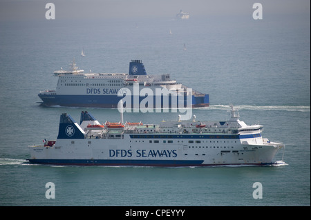 DFDS Seaways cross channel ferries passing in the Straits of Dover in southern England - Stock Photo