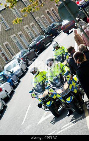 Police motorcycle outriders waiting to direct traffic for The Queen of England whilst on her diamond jubilee tour - Stock Photo