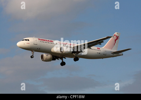 Tunisair Airbus A320 commercial airliner flying on approach - Stock Photo