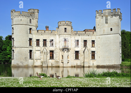 Bouchout Castle in Neo-Gothic style surrounded by moat in the National Botanic Garden of Belgium at Meise - Stock Photo