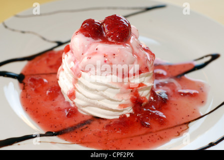 Sweet cold frozen vanilla ice cream and strawberry sauce dessert food. - Stock Photo