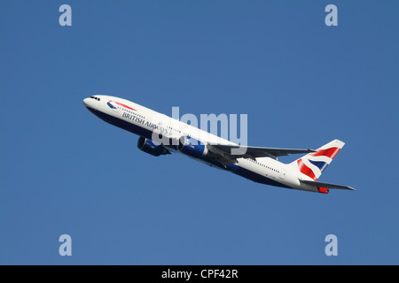 A British Airways Boeing 777 takes off from Logan International Airport. - Stock Photo