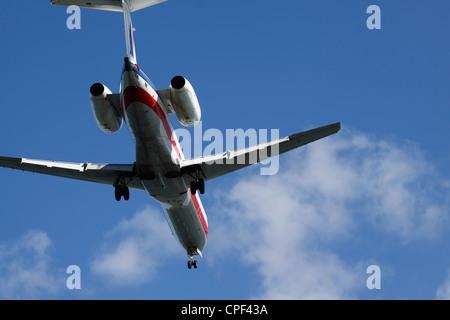 An Embraer ERJ-135 prepares to land at Logan International airport in Boston, Massachusetts - Stock Photo
