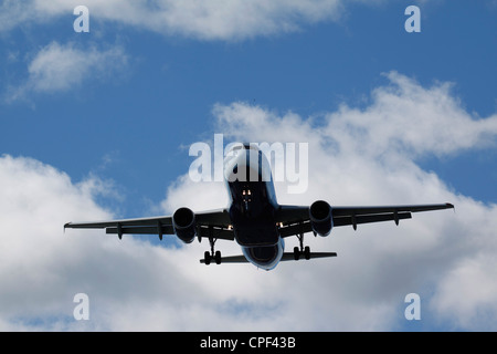 An Airbus A-320 belonging to Jet Blue airlines prepares to land at Logan International airport in Boston, Massachusetts - Stock Photo