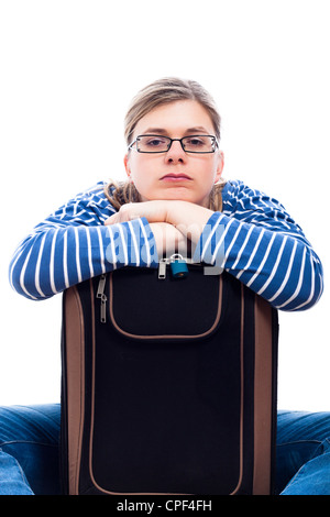 Bored traveller tourist woman waiting with luggage, isolated on white background. - Stock Photo
