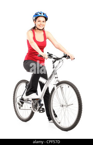 Female biker with helmet posing next to a bike isolated against white background - Stock Photo