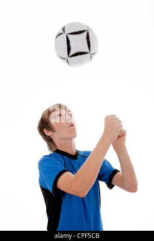 young boy practicing football or soccer - Stock Photo