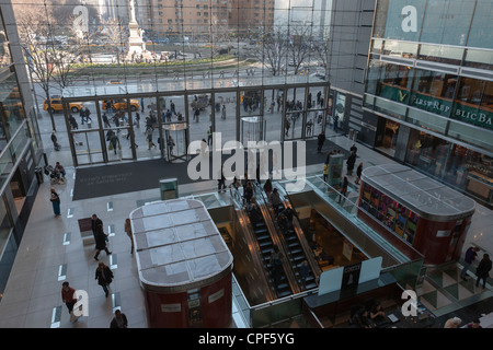 A view inside the atrium of the of the Time Warner Center, with Columbus Circle in the background, in New York City. - Stock Photo