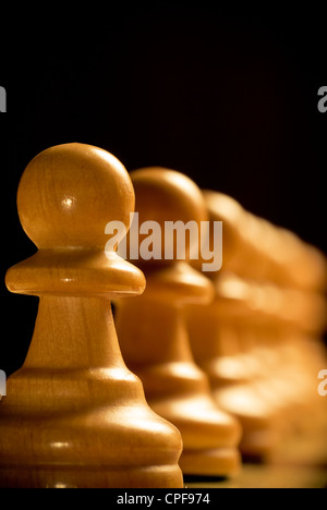row of chess pawns - Stock Photo