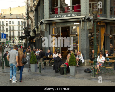 Cafe Le roi des Belges in Brussels, Belgium, with people sitting outside - Stock Photo