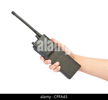 Hand holding walkie-talkie on white background - Stock Photo