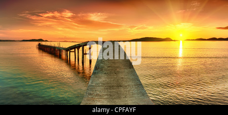Sunrise over the sea. Pier on the foreground. Panorama - Stock Photo