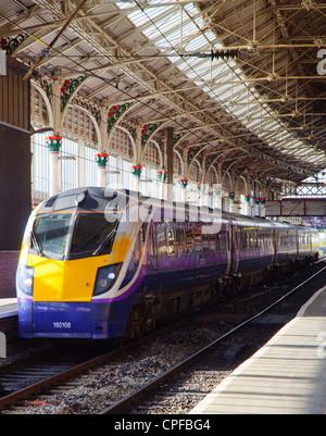 Northern Rail train at Preston Lancashire on the West Coast Main Line - Stock Photo