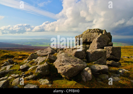 Rocks at the west top of Ward's Stone in the Forest of Bowland Lancashire England, looking to Morecambe Bay & the - Stock Photo
