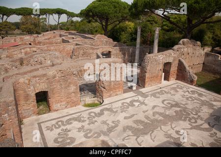 Mosaic at Terme di Nettuno at The ancient roman port town ruin of Ostia near Rome - Stock Photo