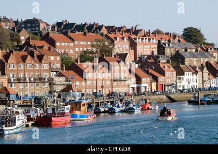 whitby harbor harbour boat boats fishing small north yorkshire coast resort town - Stock Photo