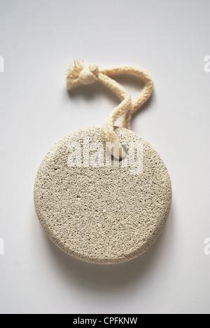 pumice stone on rope on white background - Stock Photo