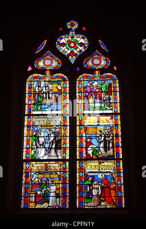Stained glass window in the Cathedral of Sarlat France - Stock Photo