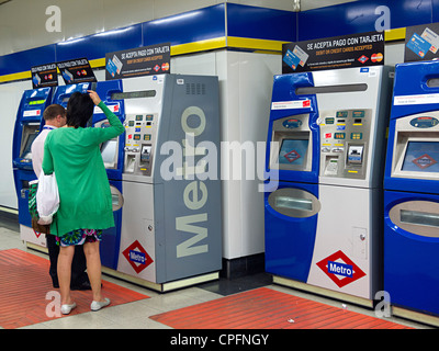 People buying tickets at automatic ticket machines at ...