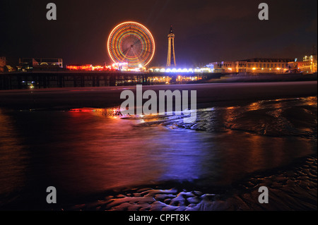 Central Pier and Blackpool Tower during Illuminations Blackpool England - Stock Photo