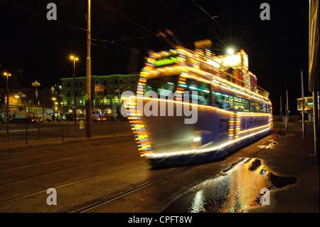Illuminated tram on Britain's oldest tram network at Blackpool during the Blackpool Illuminations - Stock Photo