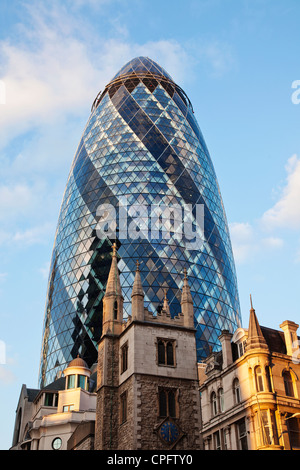 England, London, The City, The Gherkin and St.Andrew Undershaft Church - Stock Photo