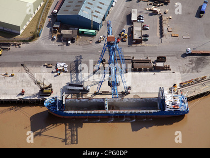 aerial view of a ship at Flixborough Docks, Lincolnshire, ready to be loaded with steel - Stock Photo