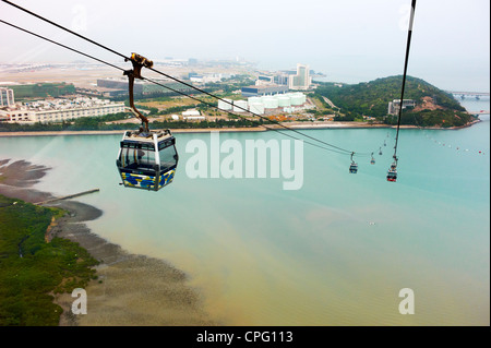 A cable car descends down the Po Lin Monastery on Ngong Ping, Lantau Island. - Stock Photo