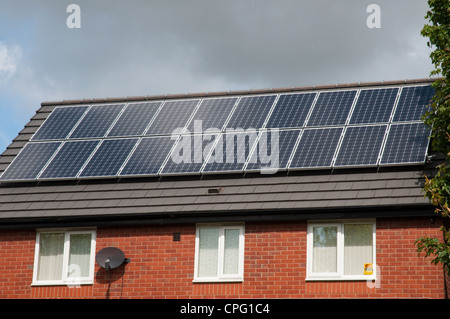 Solar panels on roof of residential property. - Stock Photo