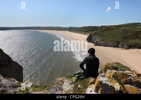 Walker Enjoying the View Over the Golden Sands of Oxwich Bay From Great Torr Penmaen Burrows Gower Wales UK - Stock Photo
