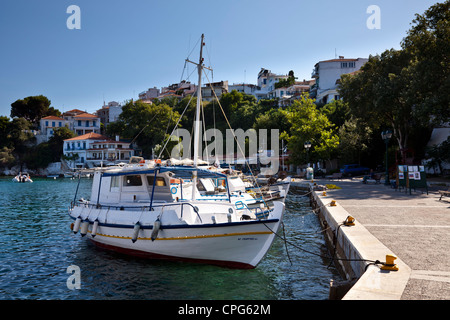 Fishing boats tied up in the harbour in the old part of Skiathos Town, Greece - Stock Photo