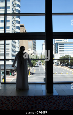 Arab businessman looking out window. - Stock Photo