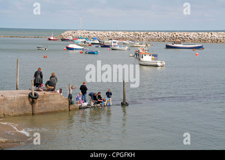 children fishing in harbour Rhos on Sea. Conway Wales - Stock Photo