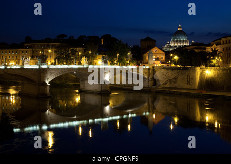 St. Peter's Basilica and the lights from the Ponte Vittorio Emanuele II are reflected in the Tiber river, Rome, - Stock Photo