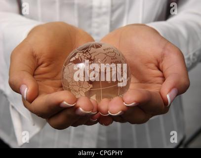 Human hand holding globe, close-up - Stock Photo