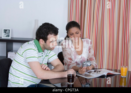 Couple looking at a camera - Stock Photo