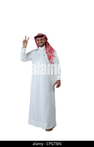 Arab man giving peace sign - Stock Photo