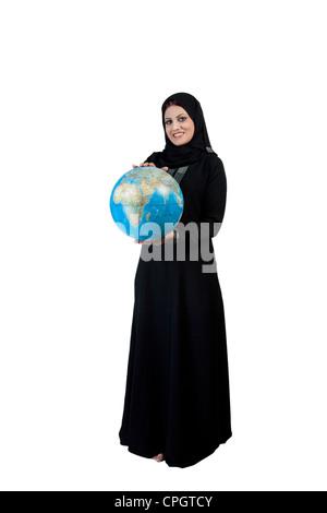 Arab woman holding a globe - Stock Photo
