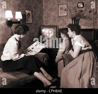 broadcast, television, family during initialization of the German television, waiting for program, woman is looking - Stock Photo