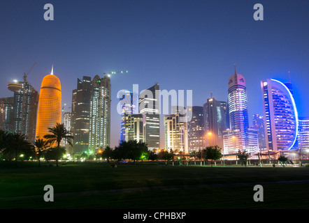 Evening view of modern skyscrapers  at night on The Corniche  in new business district of Doha in Qatar - Stock Photo