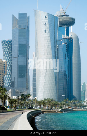 View of modern skyline with skyscrapers on The Corniche in business district of Doha Qatar - Stock Photo