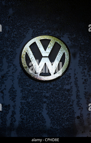 VW beetle badge covered in water drops - Stock Photo