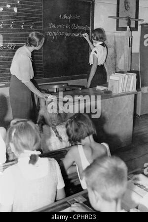 Teaching in a village school, 1943 - Stock Photo