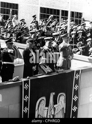 View of Adolf Hitler and Nazi naval leaders at the launch of the German heavy cruiser 'Prinz Eugen', 1938 (b/w photo) - Stock Photo