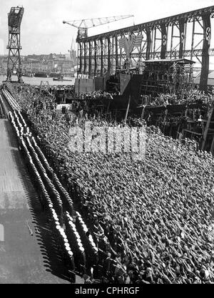 Crowds giving Nazi salute at the launching of the German heavy cruiser 'Prinz Eugen', 1938 (b/w photo) - Stock Photo